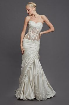 Perla D by Pnina Tornai Sweetheart Mermaid Gown in Satin This mermaid gown features a sweetheart neckline with a dropped waist in satin and beaded embroidery. It has a chapel train. This gown is Exclusive to Kleinfeld Bridal.
