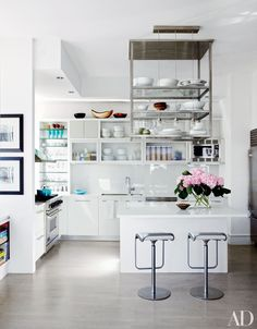 In the kitchen of actress Julianna Margulies's Manhattan home designed by Vicente Wolf, specially crafted steel shelves are suspended above the island.