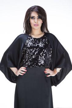 Amani Abaya is tailored using satin crepe fabric with the bodice featuring black sequin detailing.This Abaya comes with a chiffon hijab. Fabrics: Black Satin Crepe, Black Sequin fabric #abaya  #fashion #muslim #style #KSA #USAmuslim #UKmuslim #EGYPT #Jordan #islamicfashion  #jeddah #hijablover #hijaber #abayalover #abayadesign #hijabmodern #arabdesign #elegance #hijaboutfit #jeddahstyle #muslimtrend #muslimstyle #jeddahfashion #abayacollection #عباية #موضة #جدة