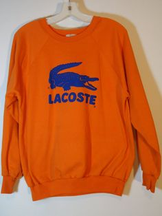 Hey, I found this really awesome Etsy listing at https://www.etsy.com/listing/209495545/vintage-orange-blue-lacoste-alligator