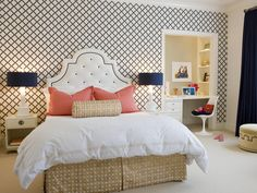 the color palette, wallpaper & nailed headboard very pretty. love the built-in workspace too.