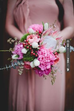 Fantastic! - pink protea wedding bouquet // photo by | CHECK OUT MORE GREAT PINK WEDDING IDEAS AT WEDDINGPINS.NET | #weddings #wedding #pink #pinkwedding #thecolorpink #events #forweddings #ilovepink #purple #fire #bright #hot #love #romance #valentines #pinky