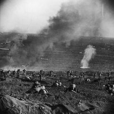US Marines advance across the beach battlefield towards the entrenched Japanese positions during the savage fight for control of the island of Iwo Jima