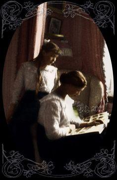 Grand Duchesses Maria (1899-1918) and Anastasia (1901-1918) Romanova of Russia browsing a photoalbum together. Year 1915.