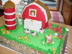 This was my first time using marzipan.  The barn was a Wilton stand up pan.  The silo was a stack of fudge stripe cookies with icing as glue...