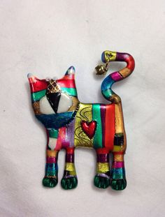 Cat pin colorful striped lucky with bell on Etsy, $12.00