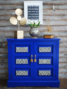 Painted Furniture | I love this cabinet makeover - bright cobalt blue, fabric accents, and arrow pulls!