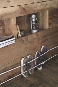 Cabane en bois habitable de en Bretagne how to store shoes with bungee cord. Only for sneakers ! Even in a wooden hut there is no lack of storage space Van Storage, Camper Storage, Storage Ideas, Organization Ideas, Trailer Storage, Kitchen Organization, Storage Shelves, Wall Shelves, Trailer Diy
