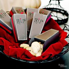 For an appropriately creepy take-home treat, fill coffin-style favor boxes with candy bones. Give the boxes a decaying look by weathering the edges with chalk. Add rub-on letters