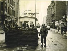 Checkpoint Charlie, probably shortly after the Wall went up, and given the sand bags and guns, possibly during the crisis in October of 1961