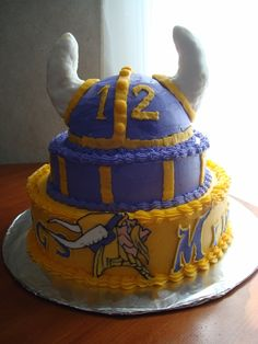 With green and gold cake on the inside. GO PACK GO!!!!!!!! Sorry Rob, I have to!!-MINNESOTA VIKINGS - Magda's Cakes
