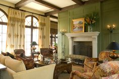 stone (limestone?) fireplace surrounded by green paneling