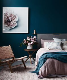 Gorgeous teal wall with grey and blush. Pink and navy.