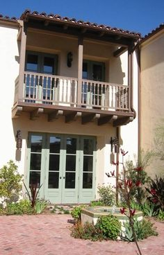 Spanish style courtyard with balcony...