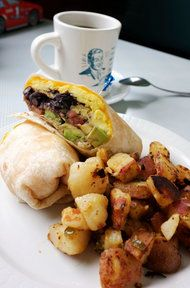 Breakfast burrito with sausage, onions, peppers, eggs & pepper cheese with hash browns
