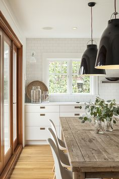 Modern Farmhouse dining set up with lots of mixed woods.  Sophie Burke Design