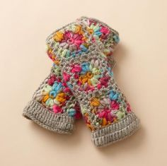 They're back! Fleece lined hand warmers. Soft wool in a colorful crocheted design.