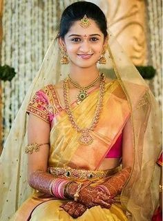 Bride in Gold Kanjeevaram Saree – Pretty bride in gold kanjeevaram bridal silk saree teamed up with pink thread work designer blouse. Blouse is designed by Bhargavi Kunam. South Indian Bridal Jewellery, Indian Bridal Sarees, Bridal Silk Saree, Indian Bridal Wear, Saree Wedding, Silk Sarees, Wedding Bride, Indian Wear, Telugu Wedding
