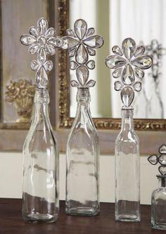 ¿A tu mamá le encanta la decoración? Entonces estas botella de cristal tapas en forma de bellas flores le encantarán.