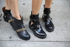leather motorcycle boots. givenchy and balenciaga.