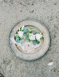 White rose boutonnieres for a classic beach wedding