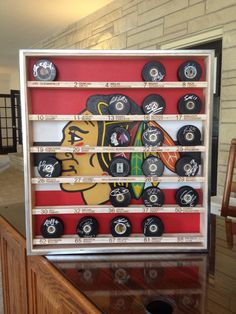 Custom hockey puck display case for the '13 Stanley Cup Blackhawks team