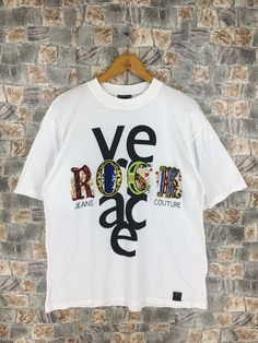 GIANNI VERSACE JEANS Tshirt Large White Vintage 1990s Versace Jeans Couture Italy Versace Medusa Printed White T shirt Size L by CaptClothingVintage on Etsy Versace Jeans Couture, Gianni Versace, T Shirt And Jeans, Yellow Stripes, Large White, Medusa, 1990s, Italy, Printed