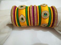 Online shopping for Silk thread bangles in India at lowest prices from Shiprocket. Shop for best selling Silk thread bangles from top sellers near you. Browse Women Jewelry products by prices, features and designs. Silk Thread Bangles Design, Silk Bangles, Bridal Bangles, Thread Jewellery, Bridal Jewelry, Indian Accessories, Hand Accessories, Women Jewelry, Fashion Jewelry