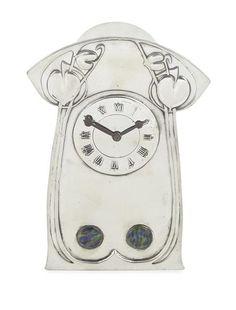 ARCHIBALD KNOX (1864-1933) FOR LIBERTY & CO., LONDON TUDRIC PEWTER AND ENAMEL MANTEL CLOCK, CIRCA 1900 20.5CM HIGH - SALE 379 - LOT 140 - LYON & TURNBULL