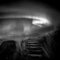 This is lovely. You don't usually see Aurora Borealis in black and white, and it gives a particular spookiness to the scene. Steps, Iceland.