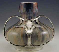 Ceramic Vase with polished pewter Art Nouveau mount by Villeroy & Boch & Van Hauten, Germany, c.1905. via Titus Omega