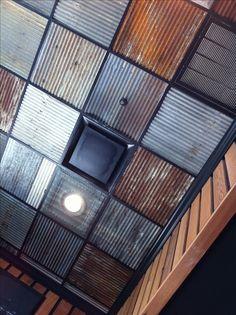 Rustic metal ceiling instead of those ugly drop-ceiling foam boards.