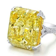 Large fancy intense yellow radiant engagement ring
