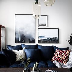 I love the combination of photography on the wall- negative space on white walls. design by Moodhouse in Stockholm / via planete deco Living Room Inspiration, Interior Inspiration, Color Inspiration, Home Interior Design, Interior Decorating, Decorating Ideas, Blue Couches, Navy Couch, Blue Pillows