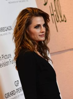 "Stana Katic from Castle. Love the commentary for this photo (so true!): This mussy 'do is what the Castle fandom refer to as ""hair porn."""
