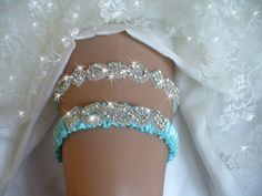 A personal favorite from my Etsy shop https://www.etsy.com/listing/176653924/something-blue-jeweled-wedding-garter