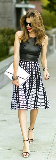 Black leather top and printed skirt. -- 60 Stylish Spring Outfits @styleestate