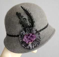 It's like a hat and fascinator in one! The detail's a bit gaudy and I wouldn't want the purple, but I like the concept.