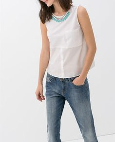 COMBINED TOP WITH NECKLACE AND POCKET