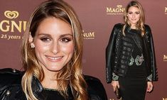 Timeless elegance! Olivia Palermo shows off her impeccable style in figure-hugging black dress as she celebrates 25-years of Magnum ice cream