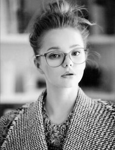 chunky necklace, collar, high bun and glasses