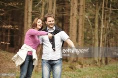 Cheerful mature couple walking hand by hand trough the forest.... #preddvor: Cheerful mature couple walking hand by hand trough… #preddvor