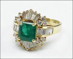 AN EMERALD, DIAMOND, AND 18 KARAT YELLOW GOLD RING. Lot 150-7161 #jewelry #emerald