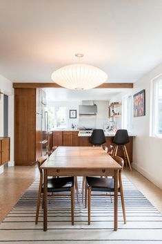 Black, white, wood is classic combo for dining room and kitchen.
