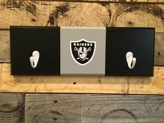 A personal favorite from my Etsy shop https://www.etsy.com/listing/474271843/oakland-raiders-2-hook-hat-coat-rack