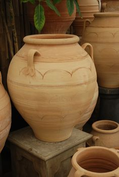 Greek Terracotta Jar. This gorgeous hand thrown greek terra cotta pot has beautiful unique markings