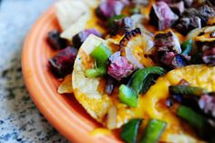 Beef Fajita Nachos - PW    These are very, very good. Flank steak marinated in chipotle, lime, garlic, and cilantro is used not for fajitas, as one might expect flank steak marinated in chipotle, lime, garlic, and cilantro to be used for…but for fajita nachos, a nice, unexpected twist.