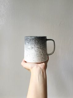 This Listing is for our brand new Appaloosa Glaze! This glaze is a lovely gradient of dark and light grey color on a cream mug. Its the perfect mug for getting cozy with on a chilly day, and its name comes from the gorgeous coloring of Appaloosa Horses. The size of these mugs ranges slightly, but generally holds 12oz. All of my work is food safe, and can be microwaved.   Paper & Clay is a small shop making small batches of handmade ceramics. My quantities are limited as I make each piece ...