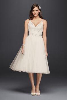 efe1813f853 This short tulle wedding dress defines ballerina chic. Appliques adorn the V -neck bodice