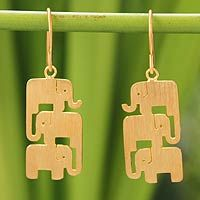 Sheets of gold vermeil receive a crushed texture and three whimsical elephants are cut out by hand to make these #earrings